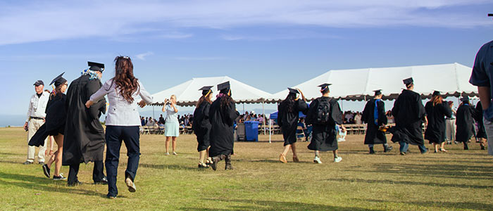 Walking to commencement event on the East Field